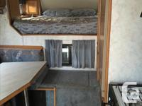 1998 Kodiak k99 9.9ft Camper. Excellent condition.