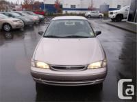 Make Toyota Model Corolla Year 1998 Colour Beige kms