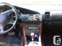 Make Acura Model TL Colour Black Trans Automatic kms