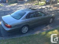 Make Acura Model TL Year 1999 Colour Silver/Teal Trans