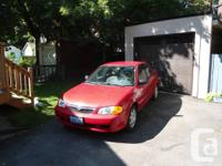 Available: 1999 Mazda Protege 1.8 L 4Cyl. Red, 5-speed