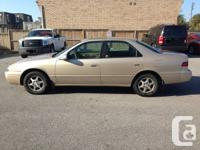 1999 TOYOTA CAMRY LE. 4 CYLINDER, AUTOMATIC, 4 DOOR.