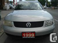 Silver with 4 cylinder automatic transmission, air-con,