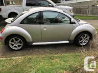 Make Volkswagen Model Beetle Year 1999 Colour Silver
