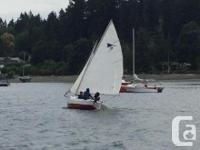 Practically an oversized sailing dinghy, flat bottomed,