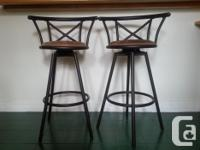 - 2 bar stools offered available - Dark brownish steel