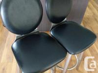 Good day, I am selling two black leather bar stools.