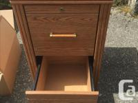 Two drawer filing cabinet. Laminate, wood like finish.