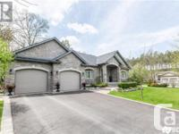 Overview STUNNING EXECUTIVE HOME! Breathtaking bungalow