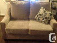 2 beautiful brand new beige love seats along with the 2