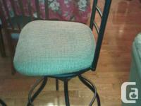 Selling two metal swivel bar stools with fabric covered