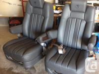 2 Grey leather captain's chairs were made be Explorer