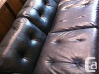 - used 2 piece faux-leather black sofa set  - great for