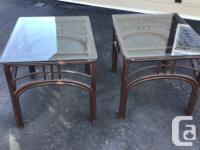 """We have 2 matching rattan 1/4 """"glass top end tables."""