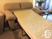 Beige coloured 2 seater sleeper sofa. Single bed