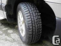 "Four 215/65R15 studded Arctic Claw ""Winter TXIs"""