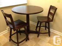 Solid timber club style table as well as swivel chairs