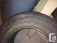 Two used tires. 185/70/14. These tires ARE NOT MATCHING