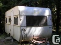 Older trailer needing upgrading inside, stove, fridge &