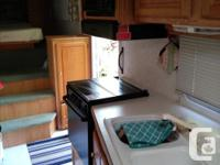 Well kept 5th wheel with lots of windows, stove, oven,