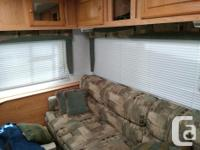 Well kept 5th wheel with lots of windows, comfy bed,