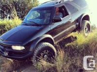 Up for sale a black 2000 chevy blazer zr2 lifted,