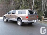 Make Dodge Colour brown Trans Automatic kms 195000 top