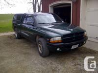 2000 Dakota with body rust. Rear wheel wells, front