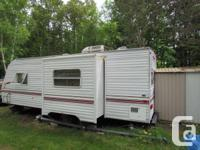 White Fleetwood Terry LITE 26 ft travel trailer in