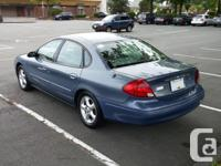 Make Ford Model Taurus Colour Blue Trans Automatic kms