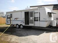 Camper sleeps 6 with main bedroom in back. There is a