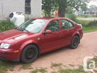 Make Volkswagen Model Jetta Sedan Year 2000 Colour red