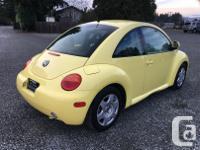 Make Volkswagen Model Beetle Year 2000 Colour Yellow