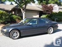 Make BMW Model 740i Year 2001 Colour Blueish-grey kms