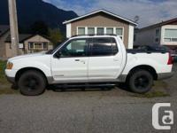 Beautiful white 2001 ford explorer sport trac 4x4 v6