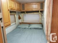 Year round RV fully insulated and double glazed. Onan
