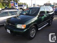 Make Nissan Year 2001 Colour Green with Grey Cloth
