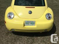 Make Volkswagen Model Beetle Year 2001 Colour Yellow