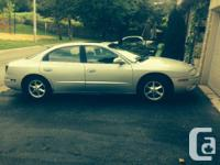 2002 Oldsmobile Aurora, 4 Door Car, Silver. Completely