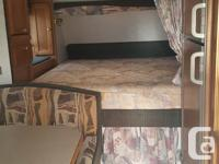 2002 Model 25C 10.6 B. Queen bed, dinette makes into