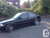 Make BMW Model 320i Year 2002 Colour black kms 198363