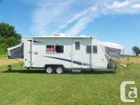 2002 21 ft. light weight Hybrid camper with canvass