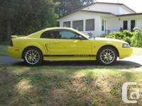 Make Ford Model Mustang Year 2002 Colour yellow kms