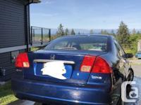 Make Honda Model Civic Sedan Year 2002 Colour blue kms