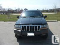 We are selling our 2002 Jeep Grand Cherokee Laredo .