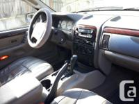 Make Jeep Model Grand Cherokee Year 2002 Colour Black