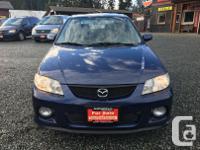 Make Mazda Model Protege Year 2002 Colour Blue kms