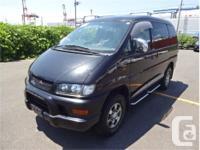 Make Mitsubishi Model Delica Year 2002 Colour Black