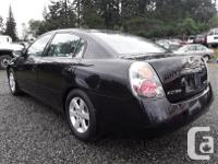 Make Nissan Model Altima Year 2002 Colour black kms