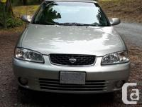 Make Nissan Model Sentra Year 2002 Colour Silver kms